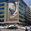 A mural of Syrian President Bashar al-Assad gazes out over Latakia, the location at which the bulk of Syrian's chemical weapons are being transfered to Western custardy for destruction. Photo source: Emesik via Wikimedia Commons