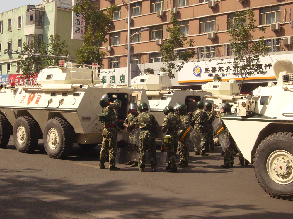 Armed police and vehicles on the streets of Urumqi in 2009. Photo source: Andrew An via Flickr Creative Commons.
