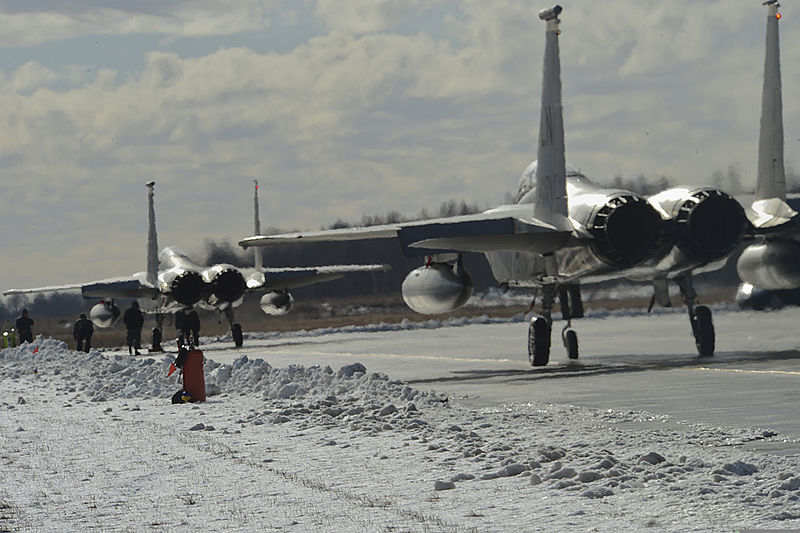 Two United States Air Force F-15C fighters - normally based in the UK - pause on the taxiway at Šiauliai International Airport, Lithuania. Source: A1C Dana J. Butler via Wikimedia Commons