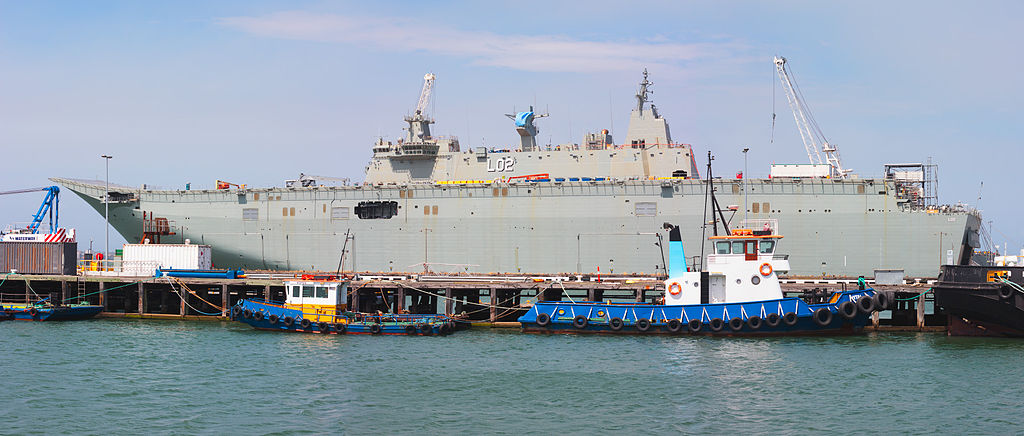 The helecopter carrier HMAS Canberra during her final stages of fitting out. Photo Source: Joe Ritson via Wikimedia Commons