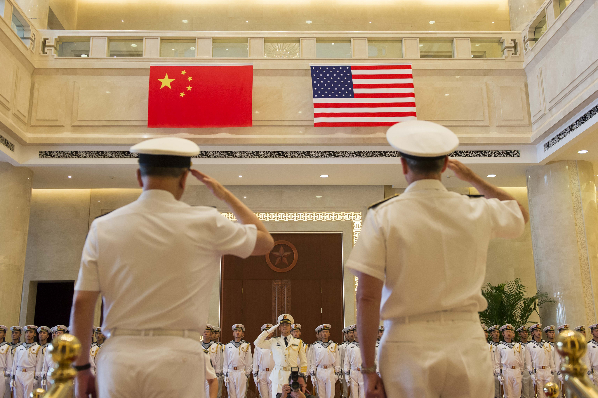 China's Chief Naval Commander Adm. Wu Shengli and U.S. Chief of Naval Operations Adm. Jonathan Greenert salute in Beijing during a July meeting. (U.S. Navy photo by Chief Mass Communication Specialist Peter D. Lawlor/Released)