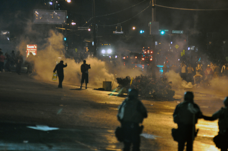 Riot police employing the use of tear gas, Ferguson day 6. Wikimedia commons.