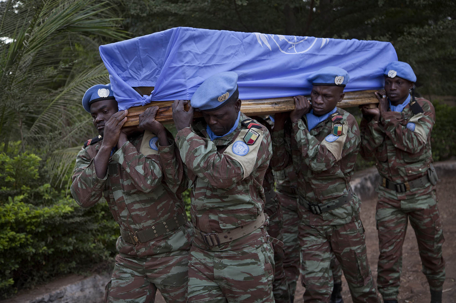Blue helmets from Benin attend a funeral in honour of 2 Senegalese peacekeepers killed in Kidal, Mali last year. Photo Source: Mission de l'ONU au Mali - UN Mission in Mali via Flickr Creative Commons