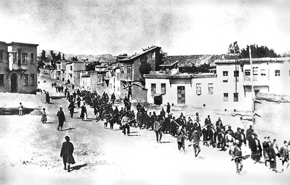 Armenians are marched to a nearby prison in Mezireh by armed Turkish soldiers.From the collection of Project SAVE Armenian Photograph Archives. Photographed by an anonymous German traveler.