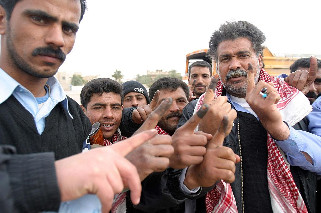 1024px-Iraqi_voters_inked_fingers