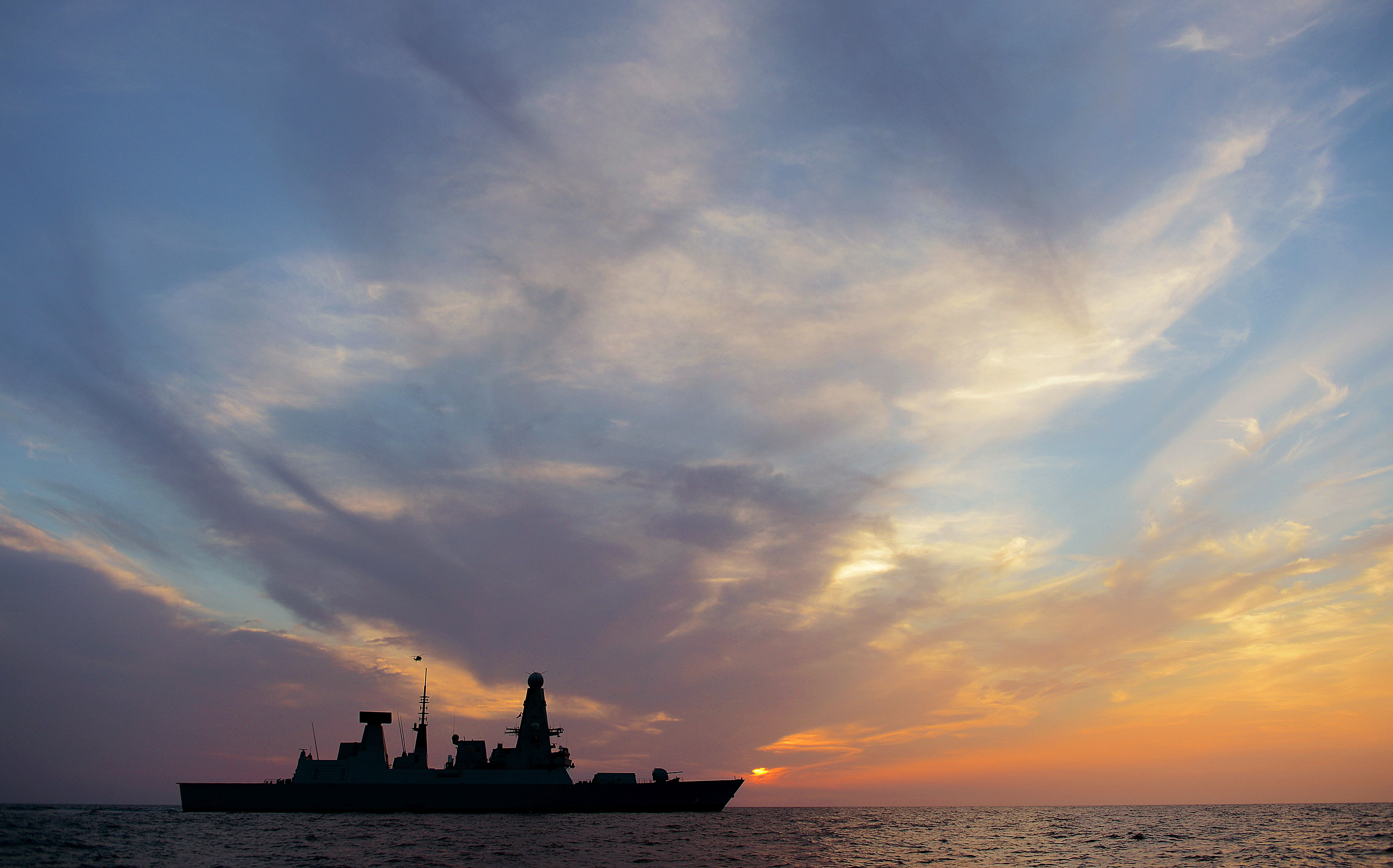 HMS Dragon crossing the setting sun during operations in the Middle East – L(Phot) Dave Jenkins via Defence Imagery