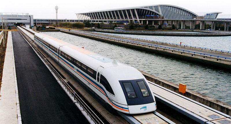 A high-speed Maglev train speeds out of Pudong airport: the kind of infrastructure Asia might expect, Alex Needham via Wikimedia Commons