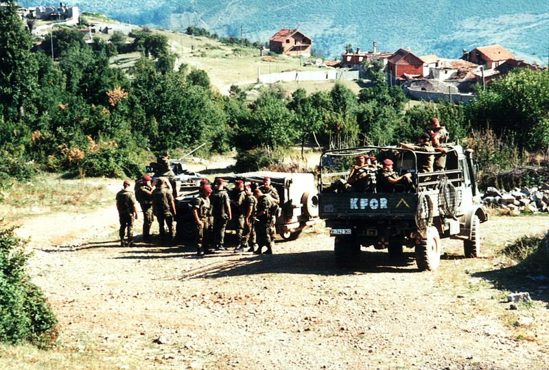 German KFOR troops patrol southern Kosovo in the Summer of 1999, Nick Macdonald via Wikimedia Commons